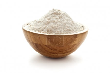 Photo for Wheay flour in wooden bowl - Royalty Free Image