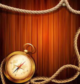Vector vintage background with a compass and marine rope