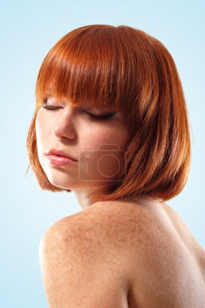 woman beautiful young make-up isolated on blue background