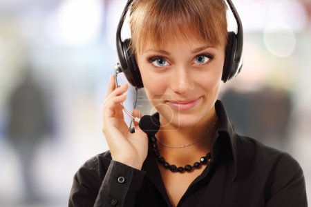 Support phone operator beautful young woman in headset at workpl
