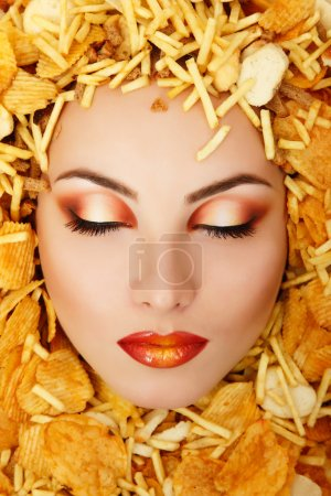 woman beauty face victim of unhealth eating fast food potato chi
