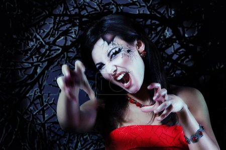 Photo for Woman beautiful halloween vampire over night background - Royalty Free Image