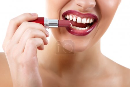 Funny portrait of young beautiful woman with lipstick make grimace and show teeth