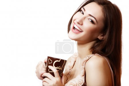 young happy beautiful woman hoolding cup of tea or coffee