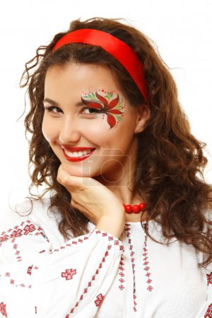 Beautiful ukrainian young woman with artistic makeup like a red flower