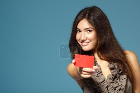 Beautiful girl showing red card