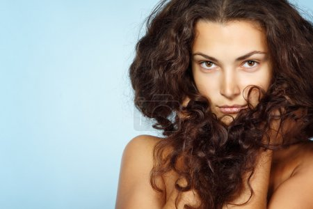 Photo for Portrait of beautiful cheerful young fresh woman with long brown healthy curly hair - Royalty Free Image