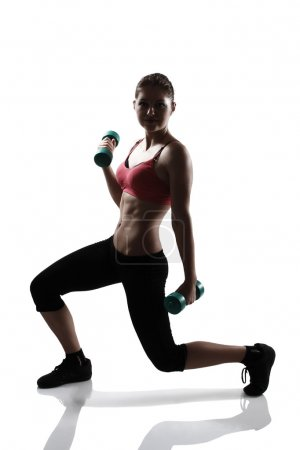 Woman doing lunge with dumbbells