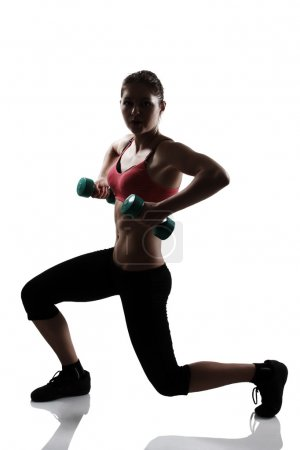 Athletic woman doing squatting