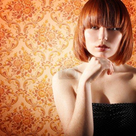 Young beautiful redheaded girl