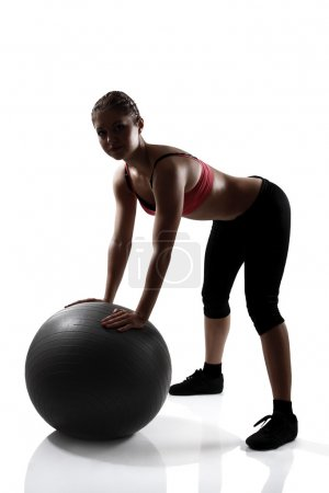 Sport girl doing exercise with fitness ball