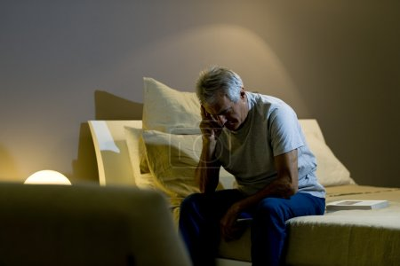 Photo for Worried senior man awakining - Royalty Free Image