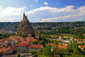 Ancient Chapelle Saint Michel de Aiguilhe standing at a very steep volcanic needle (Le Puy en Velay, France)