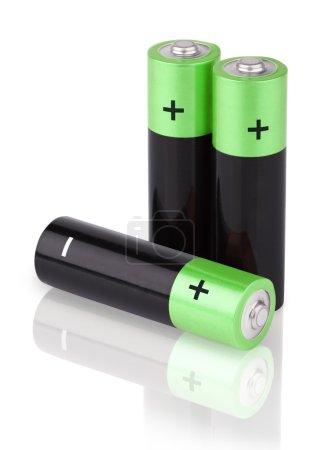 Closeup of three AA batteries