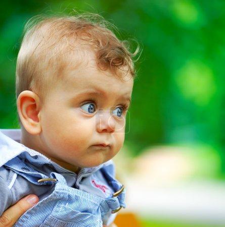 Baby boy portrait outdoor in spring