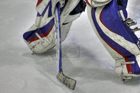 Photo for View of hockey goaltender pads and stick in defensive position - Royalty Free Image