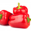 Three sweet red peppers isolated on white backgrou...