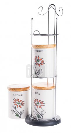 Tea coffee and sugar cannisters isolated against on white backgr