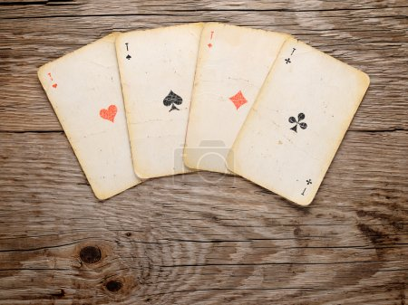 Old playing cards on wooden background
