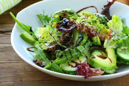 Photo for Salad mix with avocado and cucumber, with balsamic dressing - Royalty Free Image