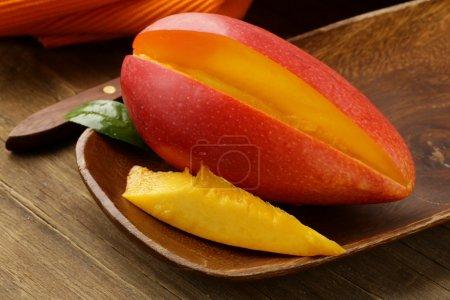 fresh fruit mango on wooden plate