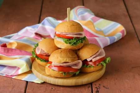 Photo for Mini burgers with ham and vegetables - snacks for parties and picnics - Royalty Free Image