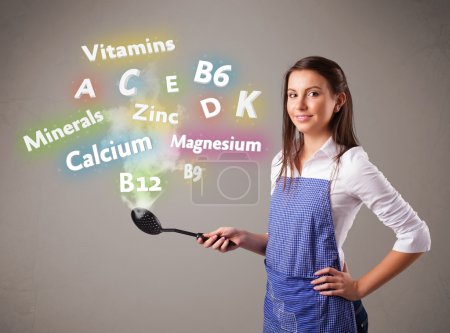 Photo for Pretty young woman cooking vitamins and minerals - Royalty Free Image
