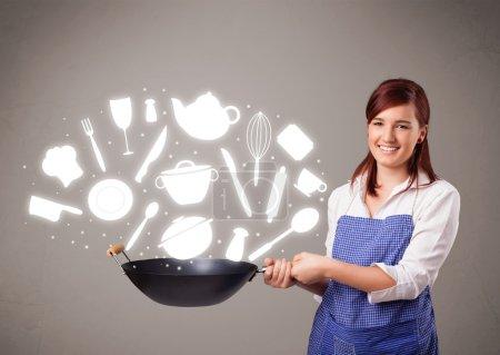 Photo pour Jolie jeune femme avec des icônes d'accessoires de cuisine - image libre de droit