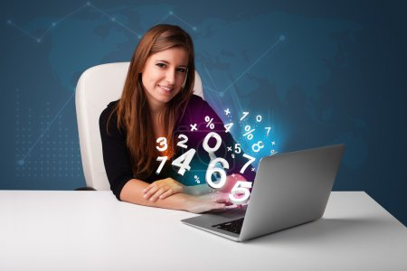 Photo for Beautiful young woman sitting at desk and typing on laptop with 3d numbers comming out - Royalty Free Image