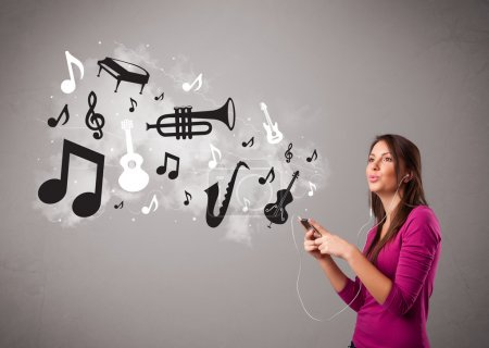 Beautiful young woman singing and listening to music with musica