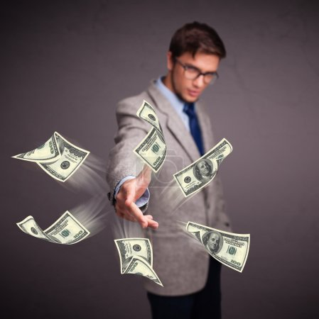 Photo for Handsome young man throwing money - Royalty Free Image
