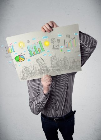 Photo for Businessman holding a paper in front of his head with charts and cityscape drawing - Royalty Free Image