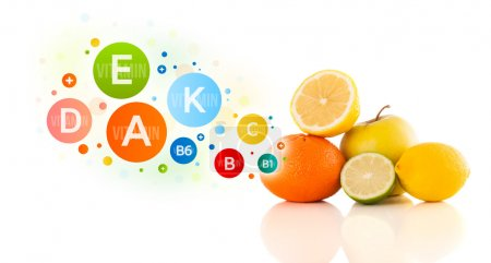 Photo for Healthy fruits with colorful vitamin symbols on white background - Royalty Free Image