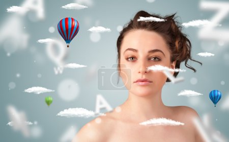 Photo for Beautiful young woman with wellness and healthcare clouds on gradient background - Royalty Free Image