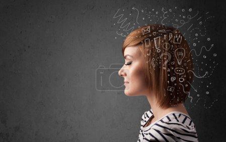 Photo pour Jeune fille en pensée avec les icônes abstraites sur sa tête - image libre de droit