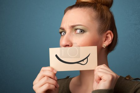 Photo for Pretty young girl holding white card with smile drawing on gradient background - Royalty Free Image