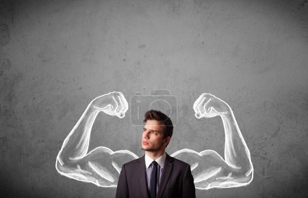 Photo for Young businessman wondering with sketched strong and muscled arms - Royalty Free Image