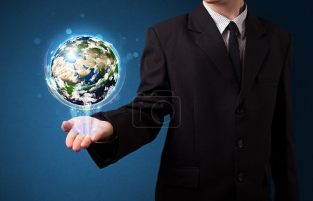 Businessman holding glowing earth globe