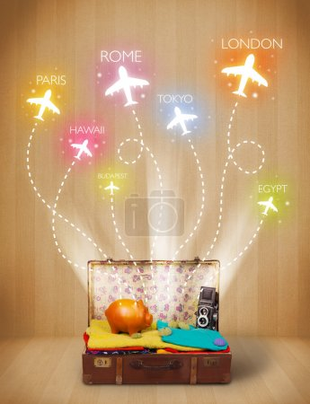 Travel bag with clothes and colorful planes flying out