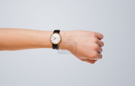 Photo for Hand with modern watch showing precise time - Royalty Free Image