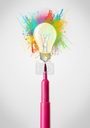 Photo for Colored felt pen close-up with colored paint splashes and lightbulb concept - Royalty Free Image