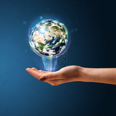 Woman holding a glowing earth globe