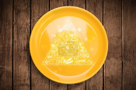 Photo for Hand drawn food pyramid on colorful dish plate and grungy background - Royalty Free Image