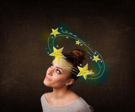 Young girl with yellow stars circleing around her ...