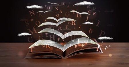 Photo pour Pages et lettres brillantes sortant d'un livre sur un pont en bois - image libre de droit