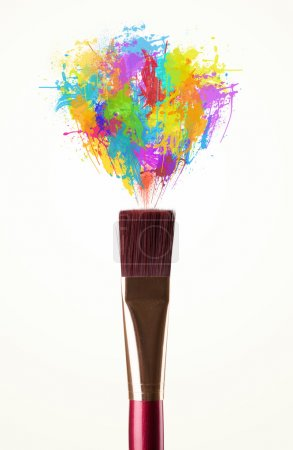 Brush close-up with colored paint splashes