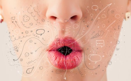 Photo for Pretty woman mouth blowing hand drawn icons and symbols close up - Royalty Free Image