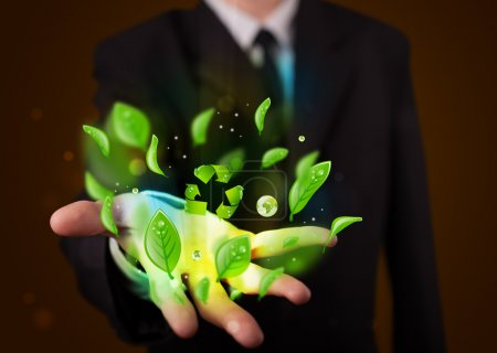 Photo for Young business man in suit presenting eco green leaf recycle energy concept - Royalty Free Image