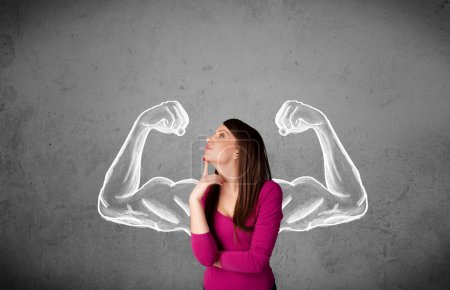 Young woman with strong muscled arms