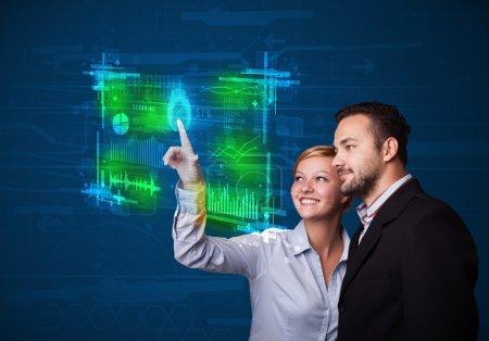 Photo pour Couple d'affaires pressant panneau de technologie moderne avec lecteur d'empreintes digitales - image libre de droit